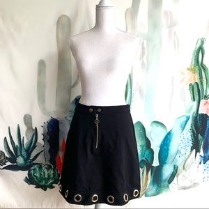 Black with gold grommet mini skirt